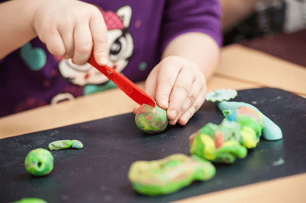 using playdough or clay to nurture childrens development